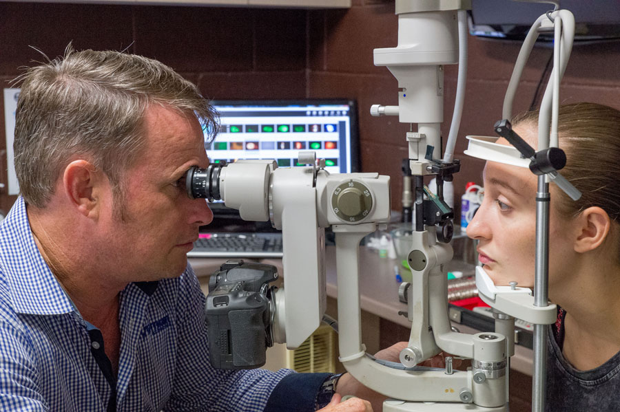 Patrick and a patient during a vision consultation